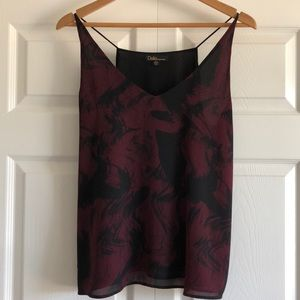 Lined polyester in burgundy black.  Never worn!
